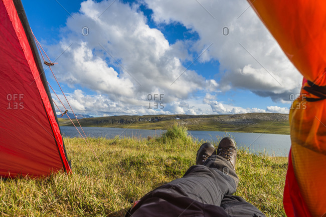 Hiker resting in tent - Offset