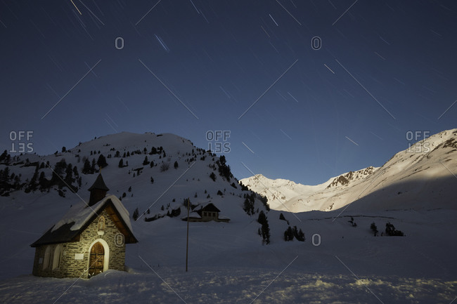 Starry sky over snow covered mountains
