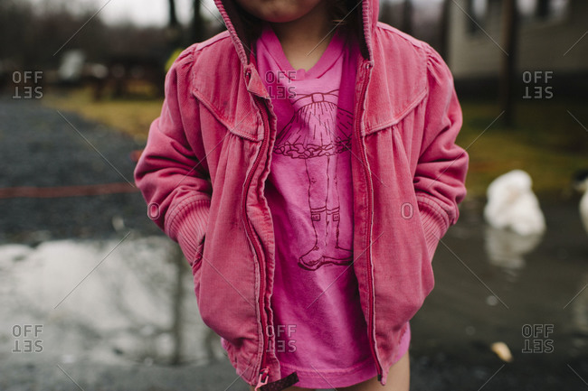 Portrait of a young girl in pink clothes