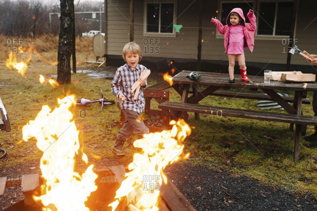 Children looking at a fire pit