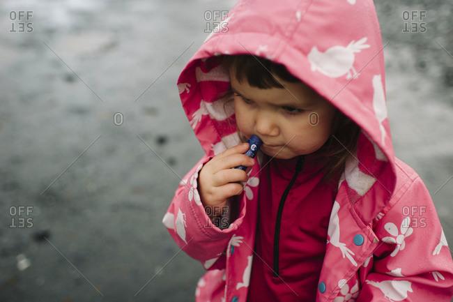 Little girl applying lip balm