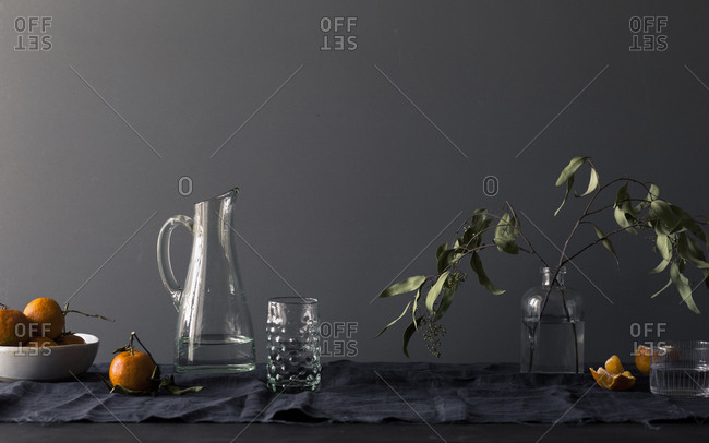 Oranges and a water pitcher