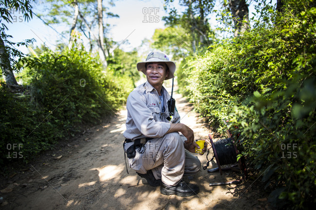 Vinh An Village, Quang Tri, Vietnam - September 10, 2014: Young man at an on site UXO removal mission in Vinh An Village, Quang Tri province, central Vietnam