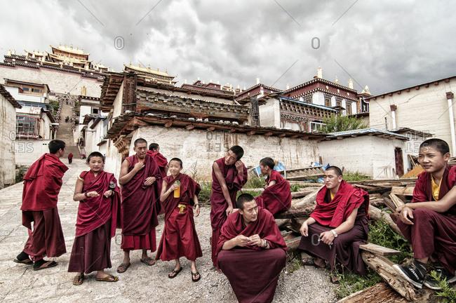 Shangri La, China - August 12, 2013: Group of Tibetan monks gathered in Ganden Sumtseling Monastery
