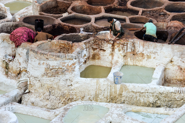 Fez, Morocco - November 18, 2014: Men working in a leather tannery