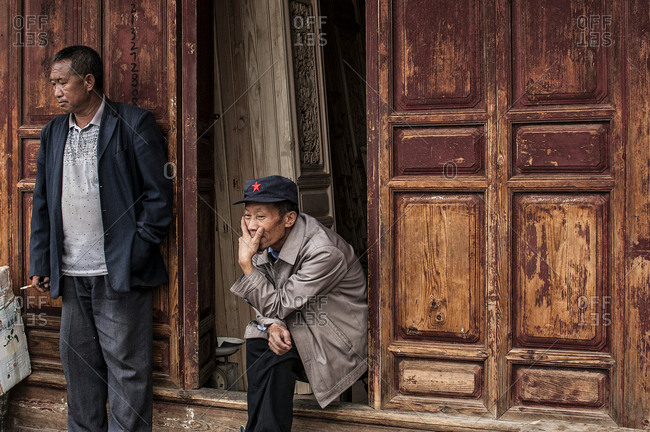 Yunnan, China - August 10, 2013: Two men resting outdoors