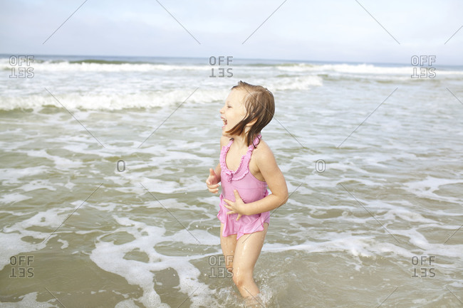 Little girl laughing in the sea