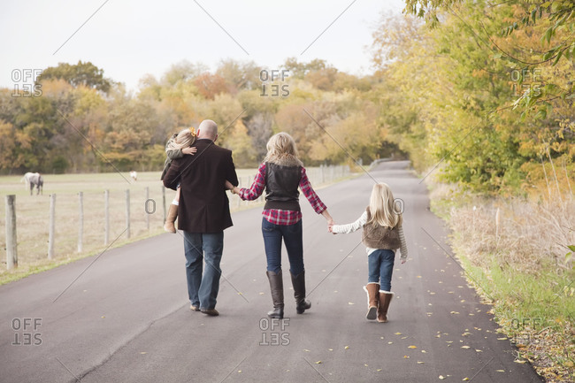 Family walking on road in the countryside