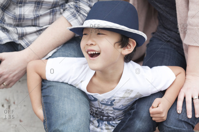 Boy laughing with parents