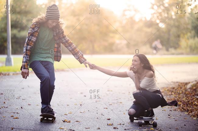 Man and woman skating together