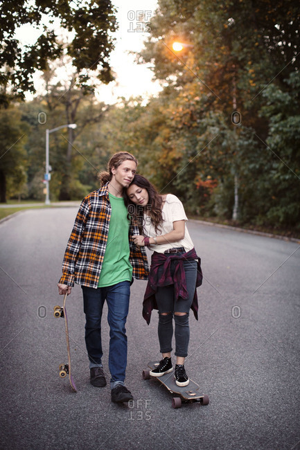 Skater couple in a park