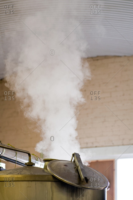 Burnley, Lancashire, UK - August 18, 2011: Steam from brewery equipment