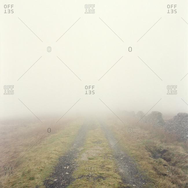 Tracks in mist in Peak District