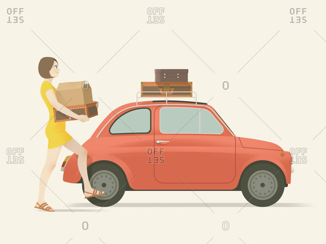 Woman carrying suitcases to car