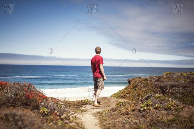Man standing on beach - Offset