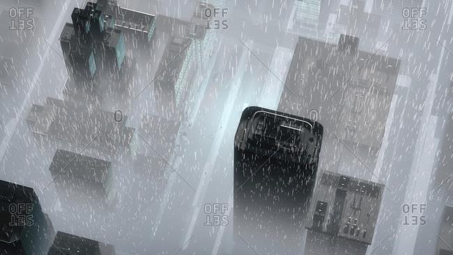 Aerial of misty skyscraper city at rainy night
