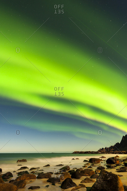 Northern lights over beach