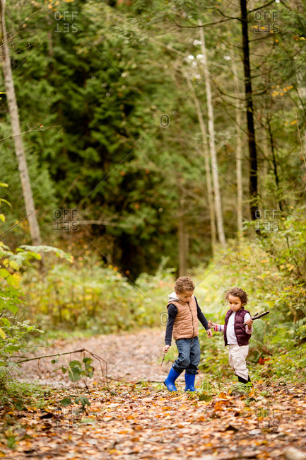 Boy and girl walking in autumn woods