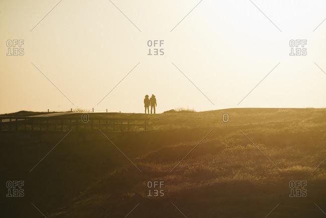 Couple walking in rural Iceland