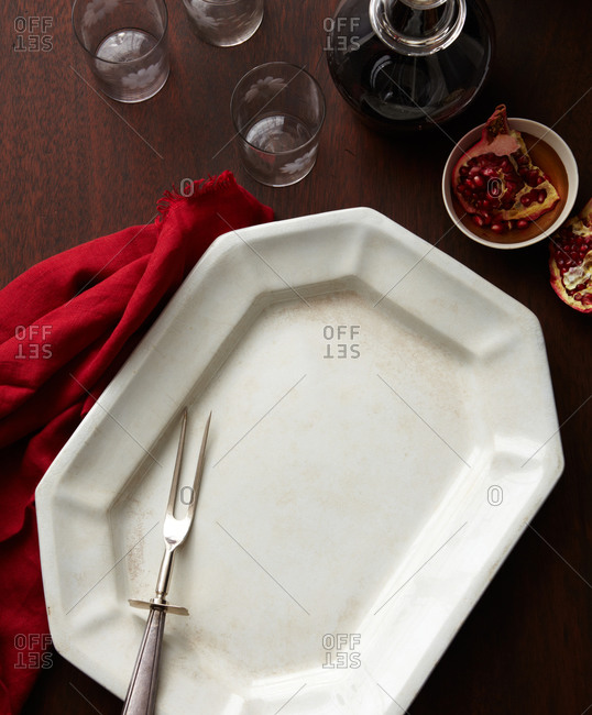 Platter and carving fork with dishes
