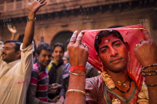 Vrindavan, India - March 14, 2014: Hijra dancing inside Bankey Bihari temple during Holi celebrations