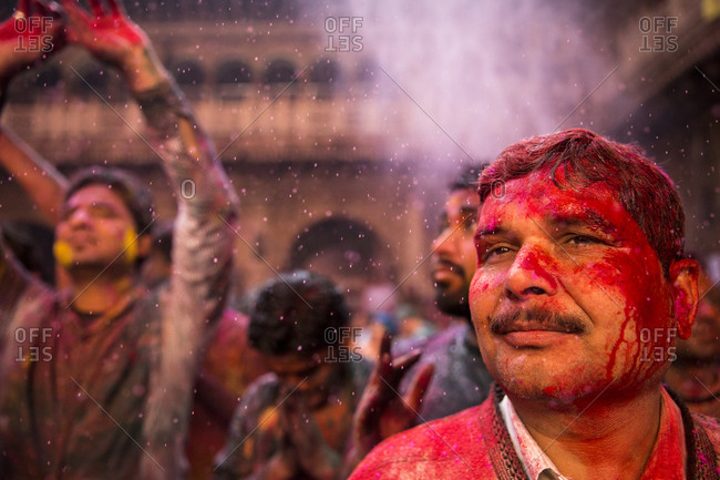 Vrindavan, India - March 14, 2014: Man attending Holi celebrations inside Bankey Bihari temple