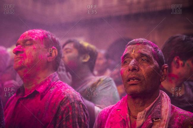 Vrindavan, India - March 14, 2014: Men celebrations inside Bankey Bihari temple during Holi Festival in Vrindavan, India