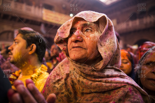 Vrindavan, India - March 14, 2014: Elderly woman praying inside Bankey Bihari temple during Holi celebrations