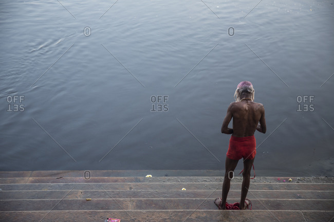 Man in the ghats of Vrindavan after bathing in the Yamuna river, India