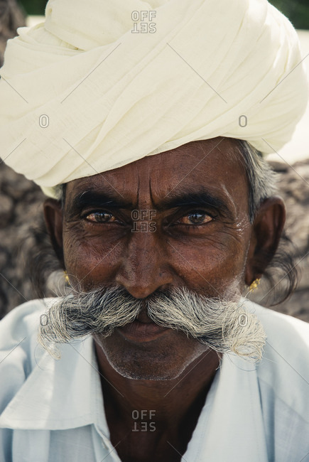 Jodhpur, India - July 26, 2008: Old man with white turban and traditional mustache