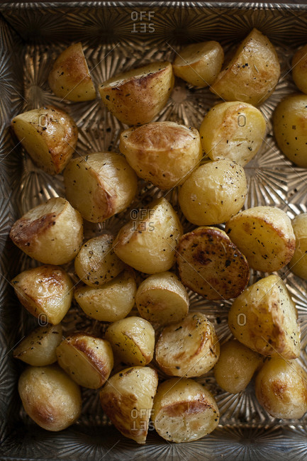 Close up of baked potatoes in a pan
