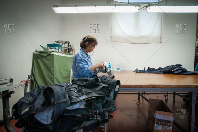 Pesaro-Urbino Province, Italy - October 31, 2014: Woman in tailor workshop