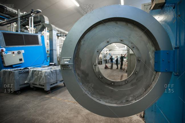 Pesaro-Urbino Province, Italy - November 4, 2014: Men working in manufacturing space
