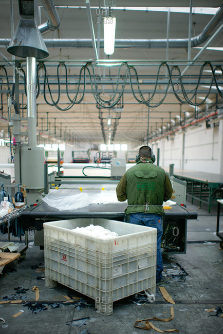 Pesaro-Urbino Province, Italy - October 31, 2014: Man working in textile factory