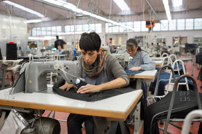 Pesaro-Urbino Province, Italy - October 31, 2014: Women working in apparel manufacturing factory