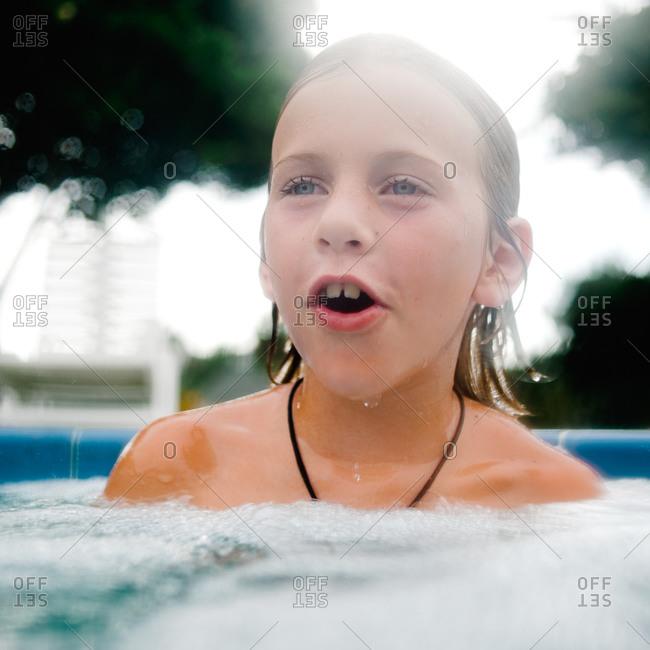 Wet boy in a pool