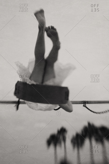 Girl on a swing in black and white