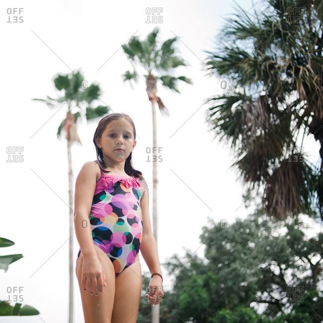 Girl standing in bathing suit