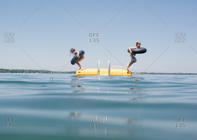 Children leaping into the water from platoon
