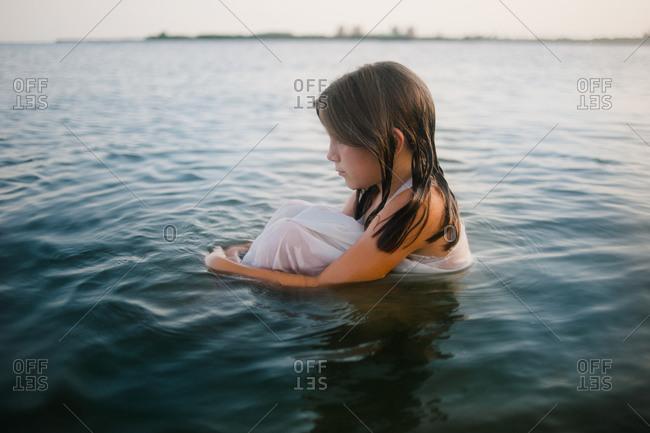Girl sitting in a lake