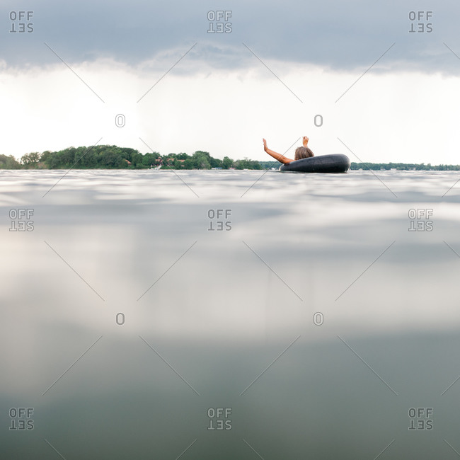Child floating on lake in an inter tube