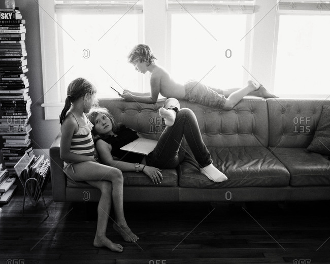 Siblings sitting on a couch
