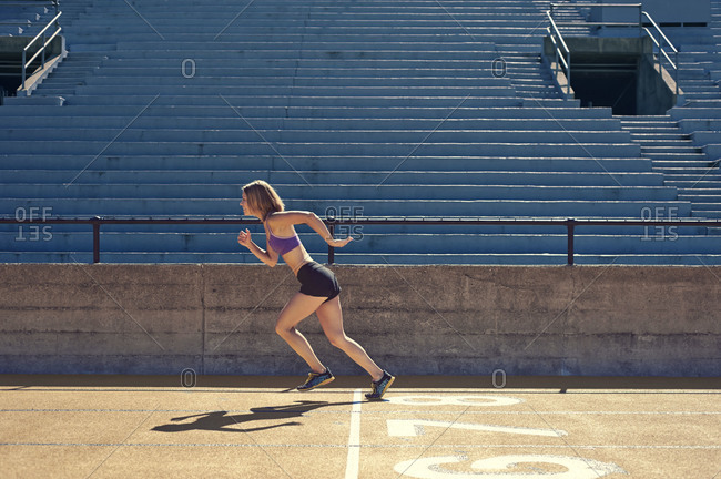 A woman sprints at a track
