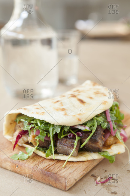 Flatbread sandwich with pork and beef carnitas