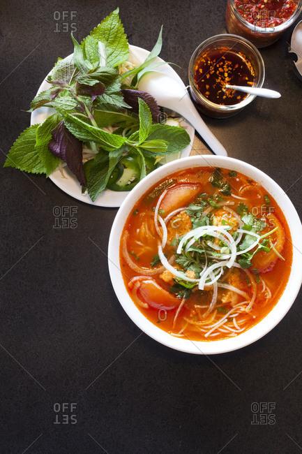 Bun rieu, a Vietnamese soup with thai basil