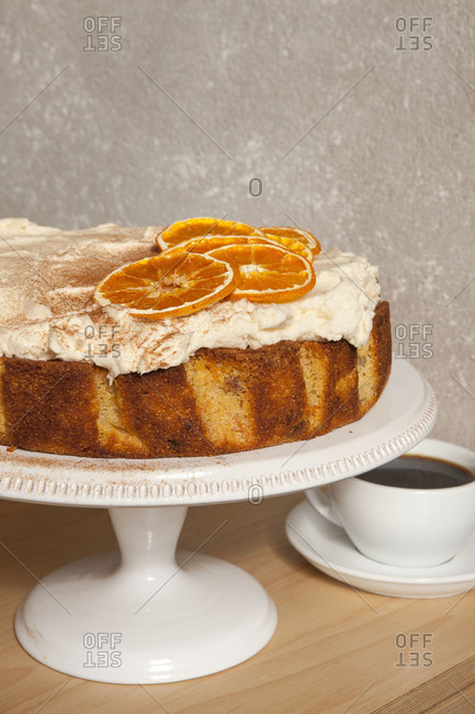 Carrot cake served with orange slices