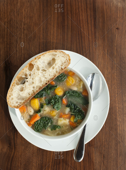 White bean soup served with a slice of bread