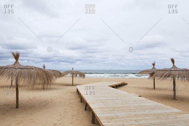 Boardwalk on a sandy beach in Uruguay