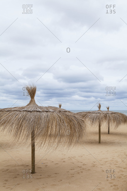 Parasols on a sandy beach in Uruguay