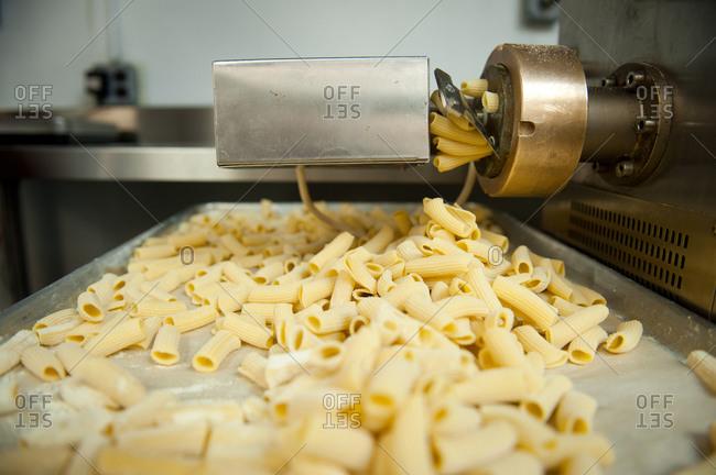 Pasta machine producing rigatoni